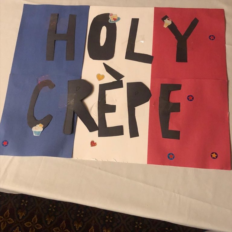 """Poster sign that reads """"Holy Crepe"""""""